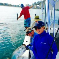 Capt Rich and crew hositing a silver king tarpon boat side after a long fought battle off St Pete