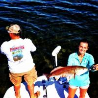 Client holding a over slot St Petersburg redfish on this fishing charter