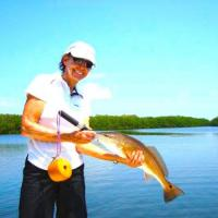 Client with a great looking redfish from her St. Pete fishing charter