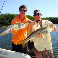 Capt Rich Andretta and client holding a pair of great looking healthy snook in St Petersburg