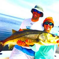 Client holding a snook of a lifetime with this Tampa Bay linesider during a Tampa Fishing Charter