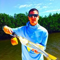Client holding a great snook caught on his Tampa fishing charter