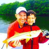 Father/Son dueo with a stellar snook action day during this Tampa Fishing charter