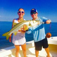 Capt Rich Andretta and client holding a trophy size snook caught from the waters of Tampa Bay