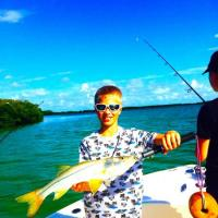 young man with a great looking beach snook caught along Anna Maria Island