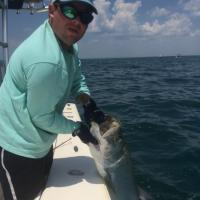 Capt Rich Andretta up close and personal with a tarpon on a tarpon fishing charter in Tampa Bay