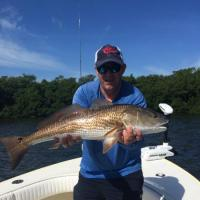 Client with a nice overslot bronze bomber AKA redfish taken from a Tampa fishing charter