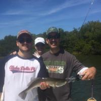 Family outting with a nice trout on a Tampa fishing charter