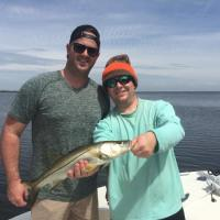 Capt Rich Andretta and client with a Tampa Bay linesider AKA snook fishing