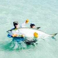 Capt Rich Andretta and client getting up close to a monster silver king tarpon on this Tampa charter