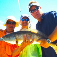 Group photo for this overslot redfish while fishing Ft Desoto in Tampa Bay